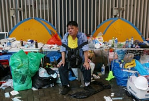 A man rests after taking part in the protest