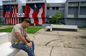Inmate Joseph Villalobos sits in the yard in the Bayamón correctional complex.