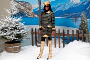 Naomi Campbell poses in tweed and gold