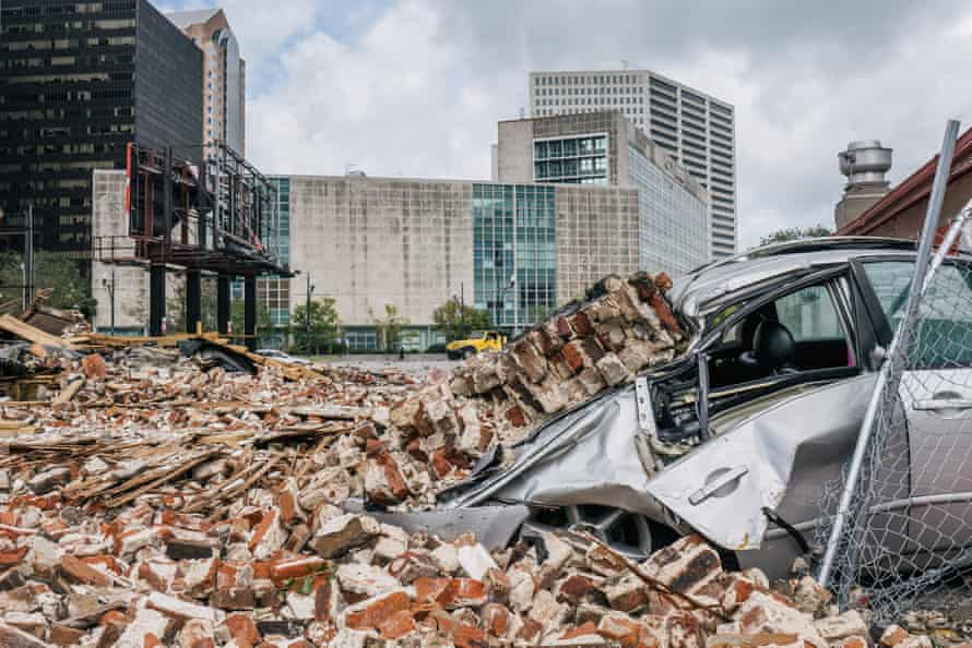 A car is seen under rubble after a building was destroyed by Hurricane Ida in New Orleans.