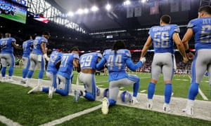 Members of the Detroit Lions take a knee during the playing of the national anthem prior to the start of the game against the Atlanta Falcons at Ford Field