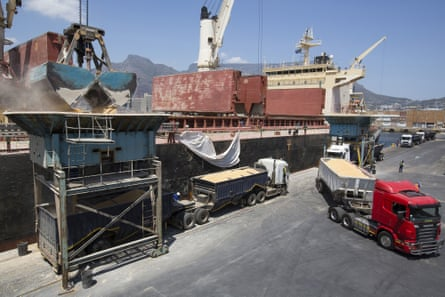 Trucks filled with imported corn maize depart after loading from a cargo ship at the city port in Cape Town, South Africa.