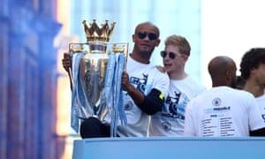 Vincent Kompany shows off the Premier League trophy during Manchester City's parade on Monday