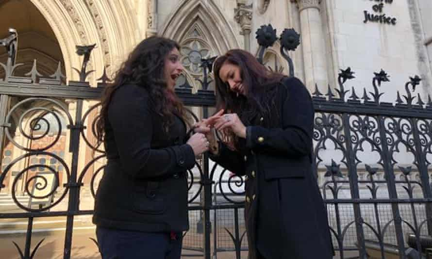 Chrissy Chambers (right) proposed to her partner, Bria Kam, outside the court on Wednesday.