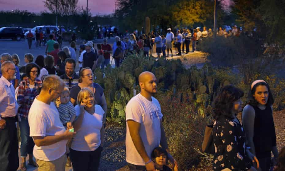People wait in line to vote in the Arizona primary in Chandler. The total number of polling stations in Maricopa County was cut to just 60 this year, down from 400 in the 2008 primary.