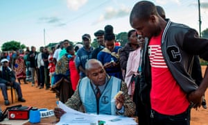 A Malawi electoral commission official checks voters' names at Masasa Primary School polling station in Mzuzu on Tuesday.