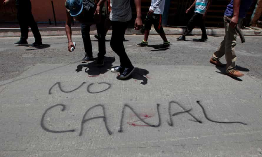 A protester sprays graffiti during a march against the construction of the interoceanic canal at Ometepe Island, Nicaragua, 15 July 2017