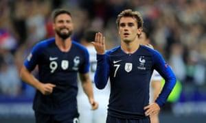 France's Antoine Griezmann celebrates scoring the second.