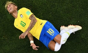 Brazil's Neymar reacts after being tackled by Switzerland's Valon Behrami