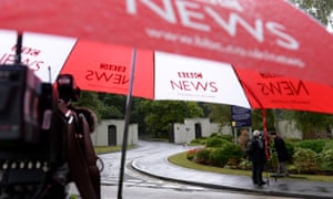 A BBC umbrella covers a TV camera outside the Berkshire estate where Sir Cliff Richard has an apartment.