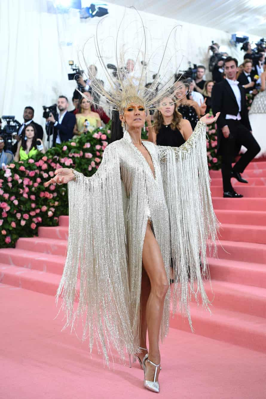Dion in champagne-toned Oscar de la Renta with fringing and peacock feathers at the 2019 Met Gala