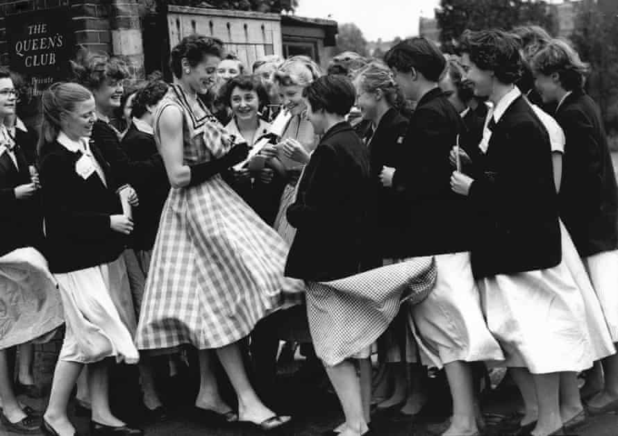 Buxton signs autographs at Queen's Club in 1956