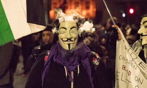 Protesters wore Guy Fawkes masks in reference to the film V for Vendetta.