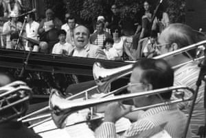 Claude Bolling, at the keyboard, performing with a big band at the Grande Parade du Jazz music festival in Nice in 1983.