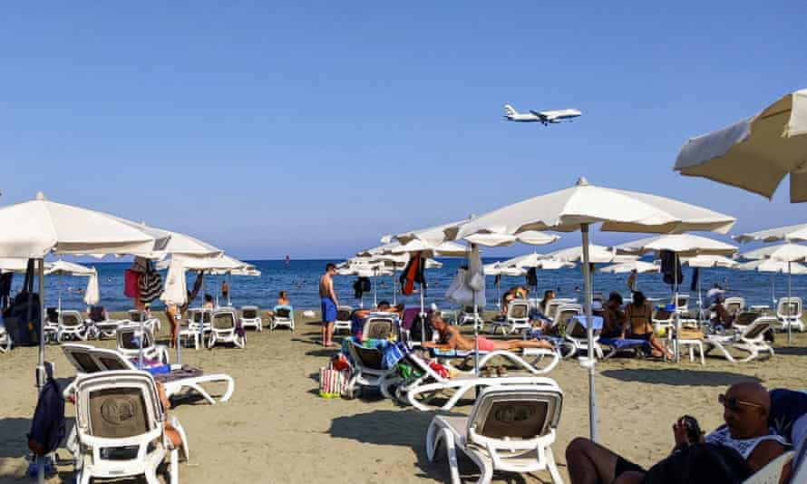 Plane flies over a beach in Cyprus