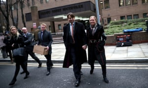 Former Tesco executive Carl Rogberg and his wife Amanda Rogberg leave Southwark crown court after his acquittal