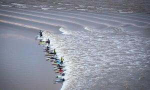 Surfers attempt to ride the Severn bore in February 2018