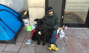 Scott Kirkbright, in central Cardiff with his dog Simba.