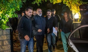 Journalist and writer Ahmet Altan being detained and walked to a car