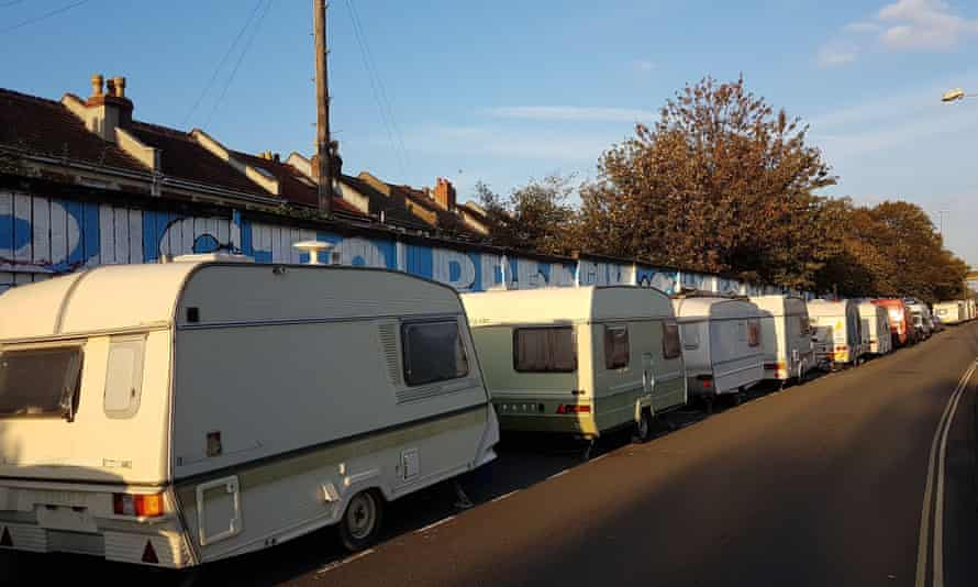Vans and caravans lines up on New Gatton Road.