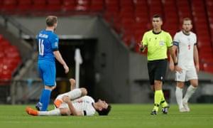 Maguire lies injured.