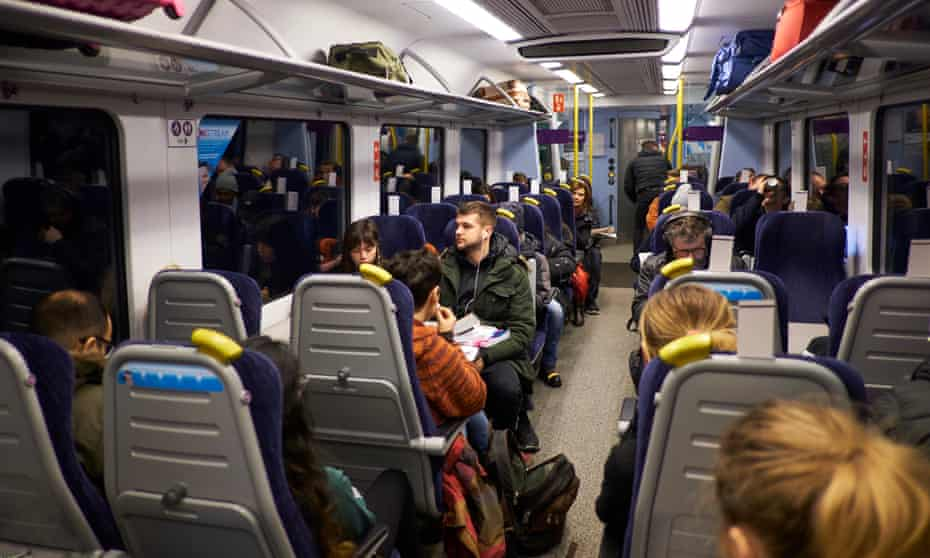 Passengers on the Preston to Manchester Piccadilly train