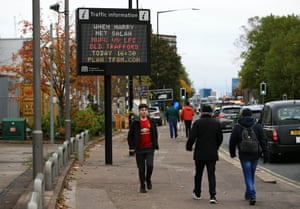 A traffic information road sign is displayed ahead of the game.