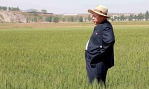 North Korean leader Kim Jong-un visiting Farm No 1116, under Korean People's Army unit 810.
