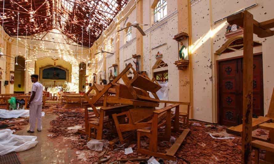 Officials inspect the damaged St Sebastian's church in Negombo after multiple explosions targeting churches and hotels across Sri Lanka.