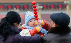 A family in Tiananmen Square, Beijing.
