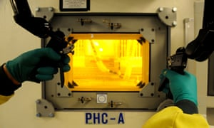 A technician uses a hot cell which shields radioactive material at the Opal nuclear research reactor at Lucas Heights in Sydney.