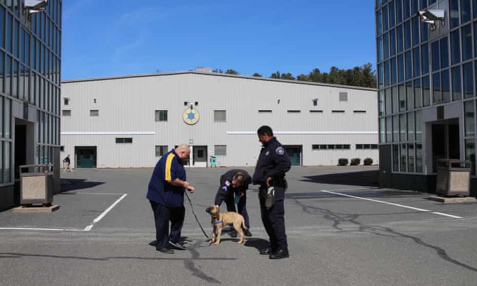Sheriff Nick Cocchi, left, on his way to visit men civilly committed for drug or alcohol abuse at the Hampden County Jail in Ludlow, Massachusetts.