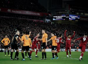 The Liverpool players celebrate Sadio Mané's goal after VAR intervention against Wolves.