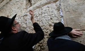 Jews pray at the Western Wall in the Old City of Jerusalem.