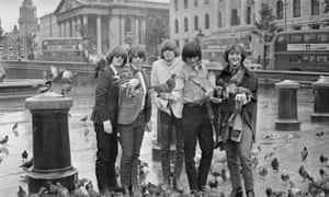 Byrds of a feather … Gene Clark (second right) with the Byrds in an overliteral London photoshoot in August 1965.