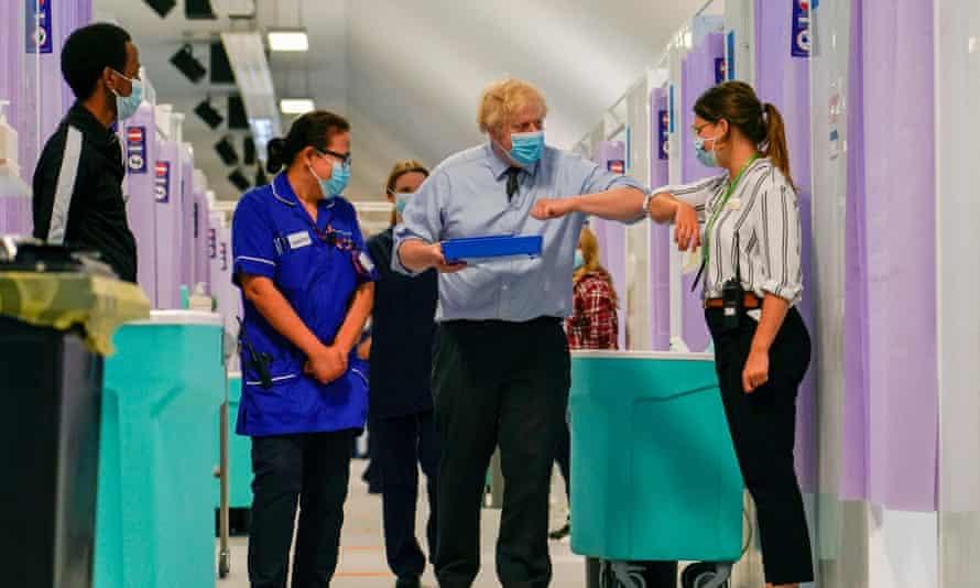 Boris Johnson visits a Covid-19 vaccination centre in north London