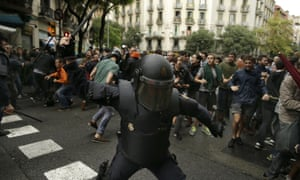 A Spanish riot police officer in Barcelona on Sunday