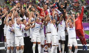 Lyon celebrate a fourth successive Champions League title after victory over Barcelona.