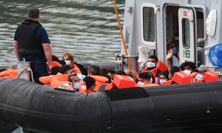 A Border Force vessel brings in migrants found off the coast of Dover on 19 August.