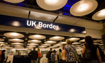 Passengers await their turn at the UK Border Agency's passport control at Heathrow.