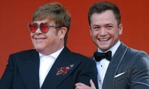 Elton John poses with Rocketman star Taron Egerton.