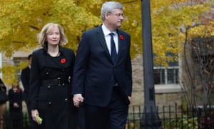 Canadian Prime Minister Stephen Harper and his wife Laureen arrive for Cpl. Nathan Cirillo's funeral service in Hamilton, Ontario October 28, 2014. Cirillo was standing guard at the National War Memorial in Ottawa last Wednesday when he was killed by a gunman who went on to open fire on Parliament Hill. REUTERS/Nathan Denette/Pool (CANADA)
