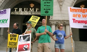 Demonstrators gather in front of the newly opened Trump International Hotel.