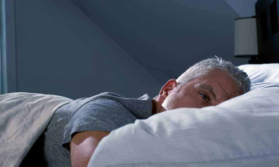 A man alone in bed
