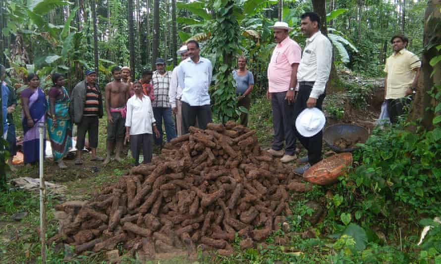 Indian archaeologists stand over rockets unearthed in Shimoga district, Karnataka state