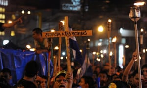 University students and members of citizens' organizations demonstrate in Tegucigalpa to demand the United Nations to form a commission to investigate a corruption scandal.