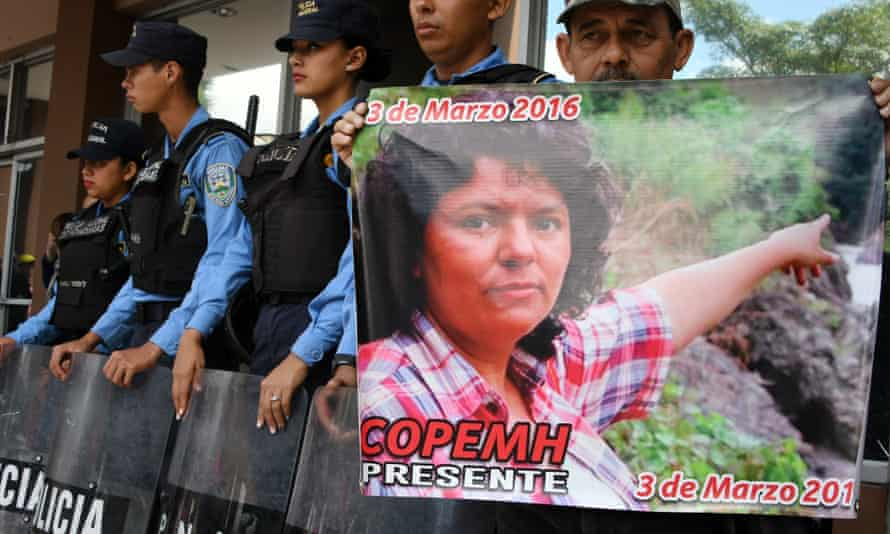 A man holds a poster during a protest in demand of justice over the murder of Honduran activist Berta Cáceres, during the second anniversary of her death, at the public ministry headquarters in Tegucigalpa on Friday.