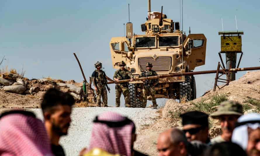 Syrian Kurds take part in a demonstration against Turkish threats at a US-led coalition base near the Turkish border.
