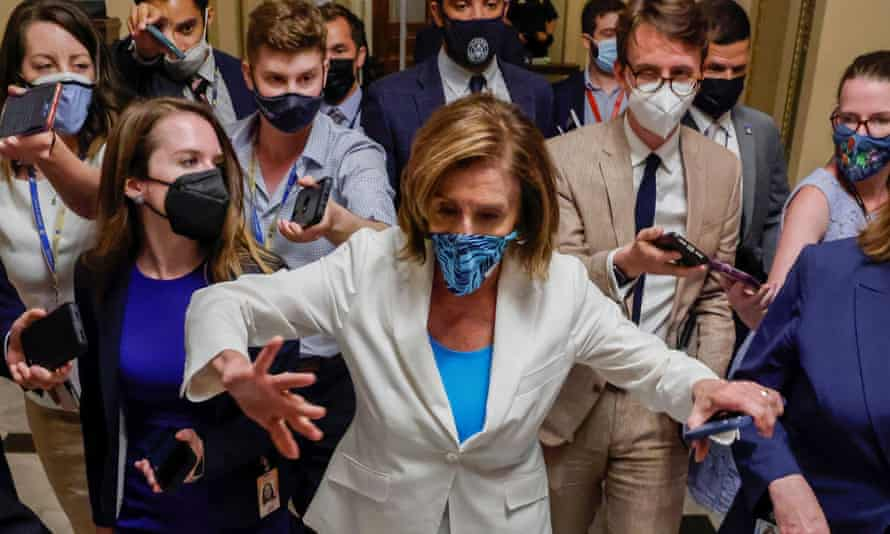 The House speaker, Nancy Pelosi, is trailed by reporters as she departs a meeting with fellow House Democrats about Joe Biden's sweeping plan to expand spending on social programs, at the US Capitol on Monday.