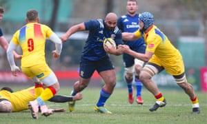 Paul Lasike breaks tackles against Romania in Bucharest.